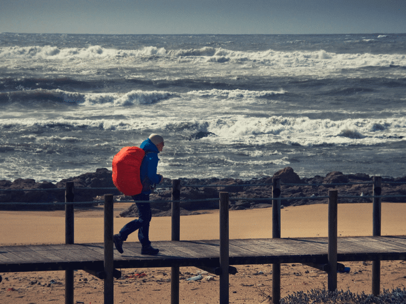 camino hiker with rough seas in the background
